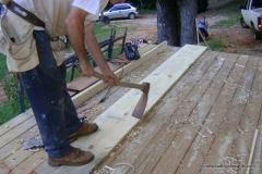 Notching the boards with a foot adze